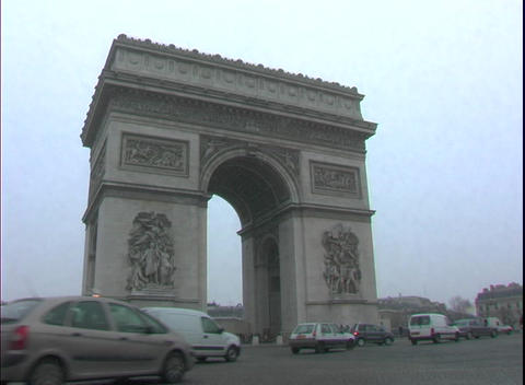 Traffic drives by the historic Arc de Triomphe in Paris,... Stock Video Footage