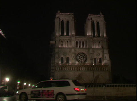 Lights illuminate the Notre Dame Cathedral at night in... Stock Video Footage
