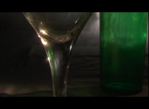 White wine and a lemon wedge fills a goblet Stock Video Footage