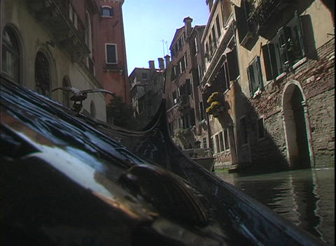 A water taxi cruises through water canals in Venice, Italy Stock Video Footage