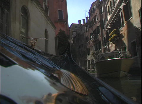A water taxi cruises through water canals in Venice, Italy Footage