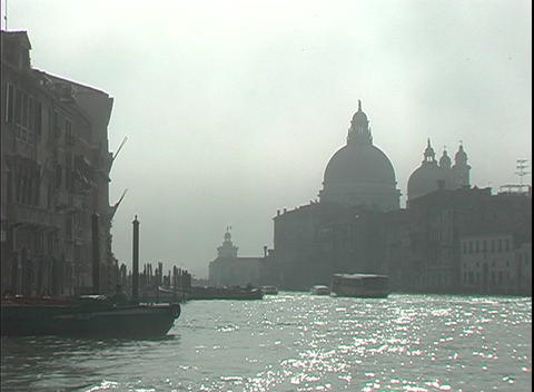 A water-taxi floats down the Grand Canal towards St. Mark's Square in Venice, Italy Footage