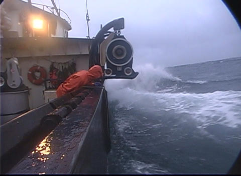 A lobster fishermen throws a rope out and catches a buoy... Stock Video Footage