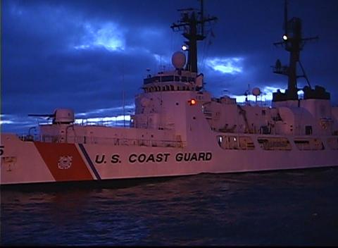 The U.S. Coast Guard ship waits for a call in a calm sea Stock Video Footage