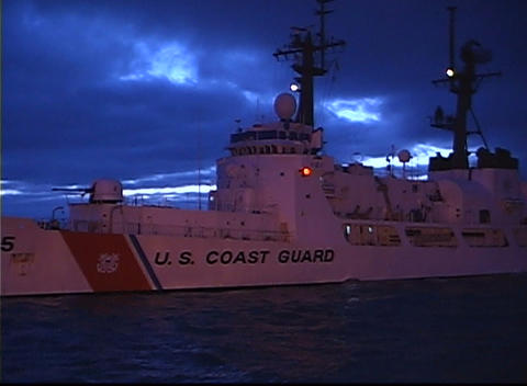 The U.S. Coast Guard ship waits for a call in a calm sea Footage