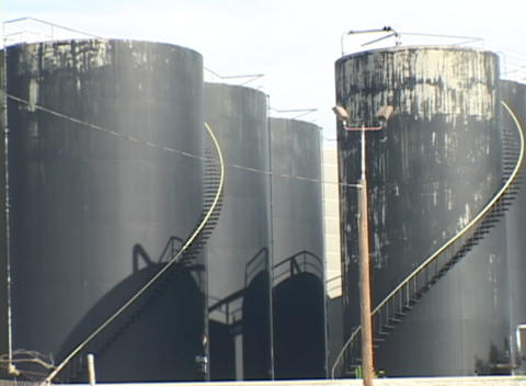 The camera pans across rows of large black industrial... Stock Video Footage