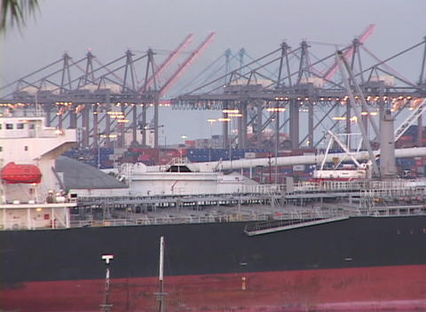Medium shot of cargo ships at Long Beach, California harbor Footage