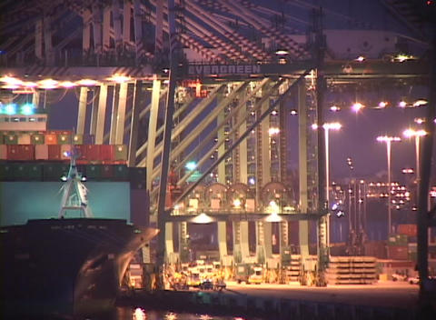 Medium shot of night time activity in a busy container port Stock Video Footage