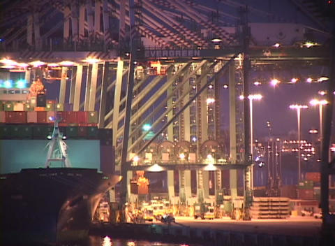 Medium shot of night time activity in a busy container port Footage