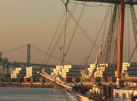 Medium shot of a sailing vessel passing through a cargo... Stock Video Footage