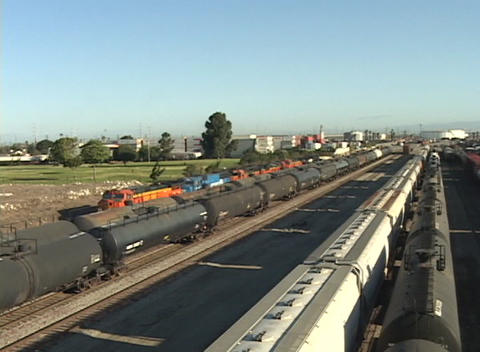Pan-right across a railroad yard with freight trains and... Stock Video Footage