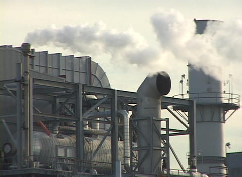 Medium shot of steam rising from smokestacks at a large... Stock Video Footage