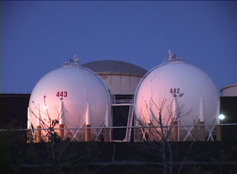 Medium shot of oil storage tanks at an industrial complex Stock Video Footage