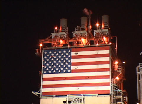 Close up of an American flag on the side of an oil-refinery Stock Video Footage