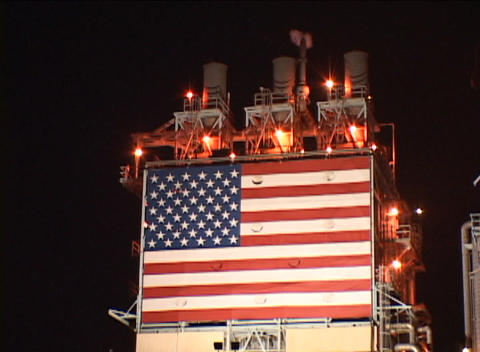 Close up of an American flag on the side of an oil-refinery Footage