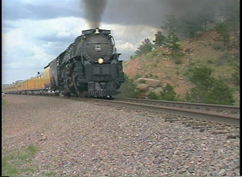Tracking-out shot of a Union Pacific steam passenger... Stock Video Footage
