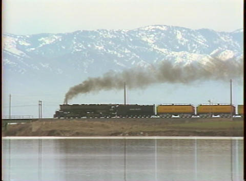 Tracking-right shot of a steam train passing in front of... Stock Video Footage