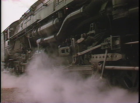 Close-up of steam coming from the front of a locomotive... Stock Video Footage