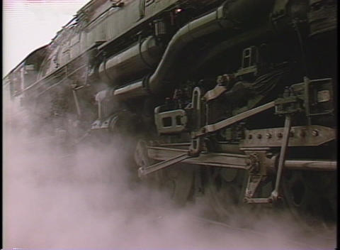 Close-up of steam coming from the front of a locomotive as it begins to move Footage