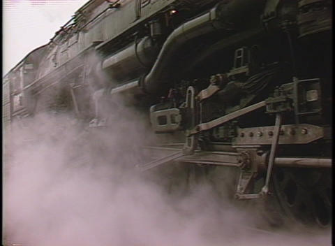 Close-up of steam coming from the front of a locomotive as it begins to move Live Action