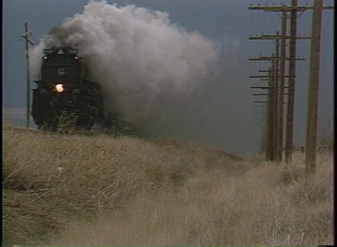 Tracking-out shot of steam billowing from a old-fashioned... Stock Video Footage