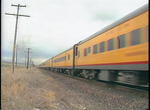 Medium shot of Union Pacific passenger train cars passing by Stock Video Footage