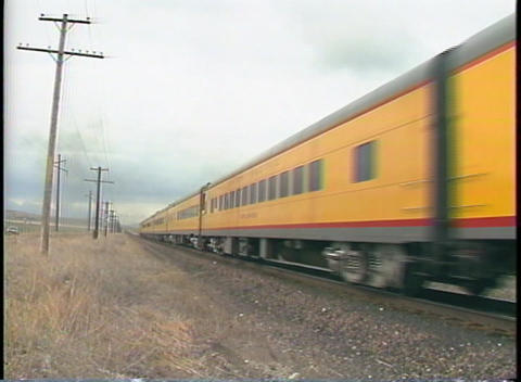Medium shot of Union Pacific passenger train cars passing by Footage