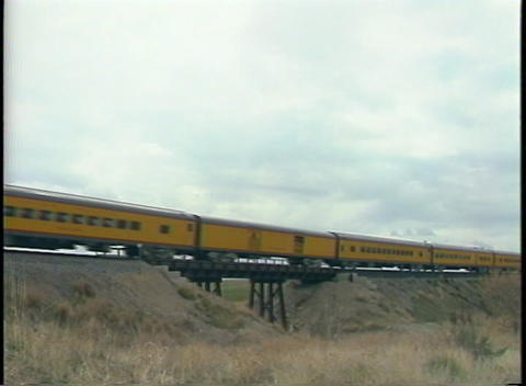 Medium shot of a steam passenger train going over a small... Stock Video Footage