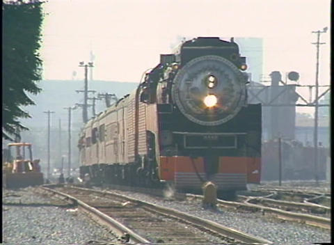 Zoom-out from a Southern Pacific steam passenger train... Stock Video Footage