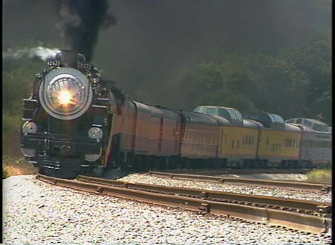 Tracking shot of a Southern Pacific steam passenger train... Stock Video Footage