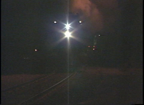 Tracking shot of a steam train approaching and passing in... Stock Video Footage