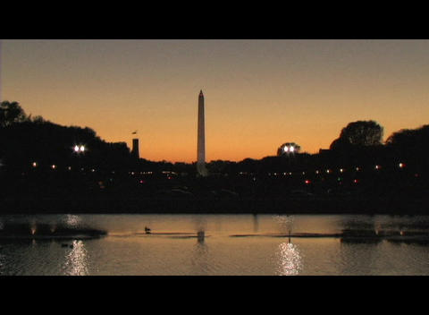 Long-shot of the Washington Monument during the golden-hour Stock Video Footage