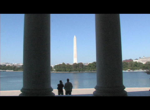Long-shot of the Washington Monument through the pillars... Stock Video Footage