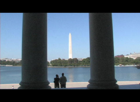 Long-shot of the Washington Monument through the pillars of the Lincoln Memorial Footage
