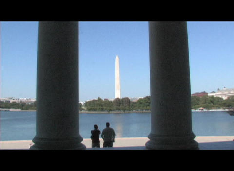 Long-shot of the Washington Monument through the pillars... Stock Video Footage