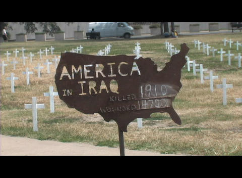 Medium-shot of a sign in a cemetery noting deaths and wounded in the Iraq war Footage