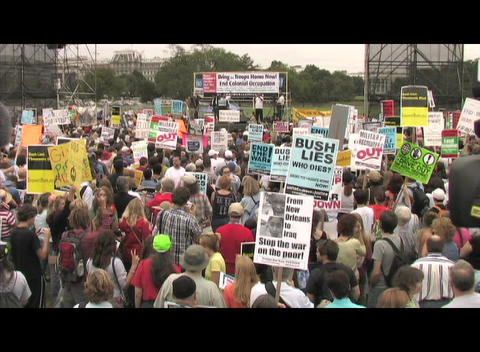 Medium-shot of a large war protest in Washington DC Footage