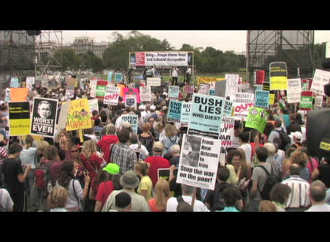 Medium-shot of a large war protest in Washington DC Stock Video Footage