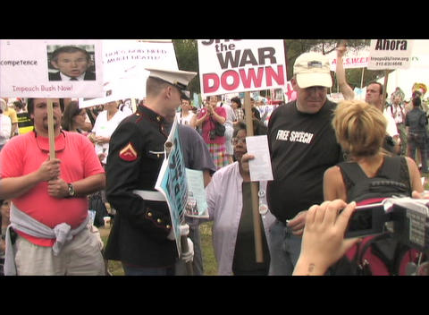 Zoom-in on a Marine in uniform protesting the war in Iraq Stock Video Footage