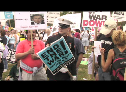 Zoom-in on a Marine in uniform protesting the war in Iraq Footage