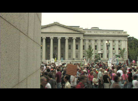 Long-shot of anti-war protesters marching past the . .... Stock Video Footage