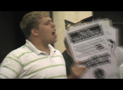 Medium-shot of a 20-something, Iraq-War supporter... Stock Video Footage