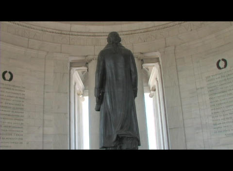 Long-shot from behind of the Thomas Jefferson statue in the memorial in Washington DC Live Action