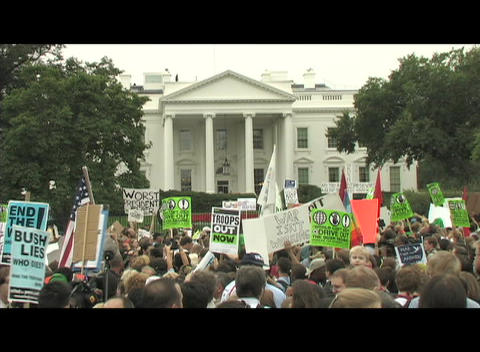 Medium-shot of anti-Iraq war protestors demonstrating in front of the White House Footage