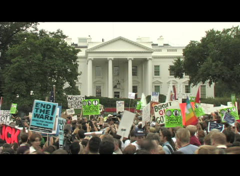 Medium-shot of anti-Iraq war protestors demonstrating in... Stock Video Footage
