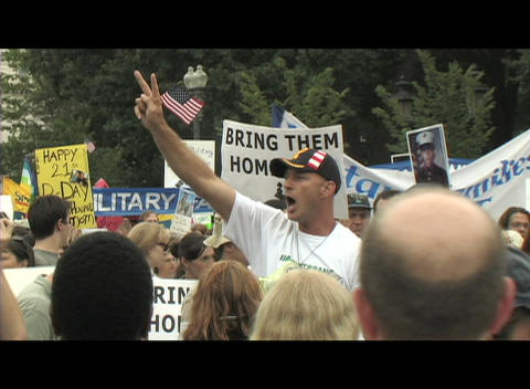Medium-shot of a 40-something man protesting at an... Stock Video Footage