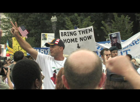 Medium-shot of a 40-something man protesting at an anti-Iraq-war rally in Washington DC Footage
