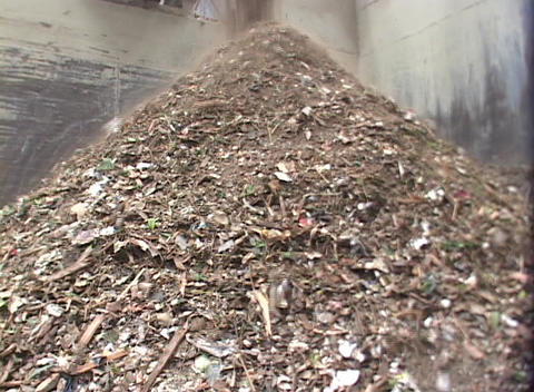 Debris pours into a pile at a recycling center Stock Video Footage