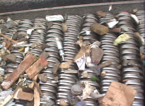A conveyor belt separates garbage at a recycling center Stock Video Footage