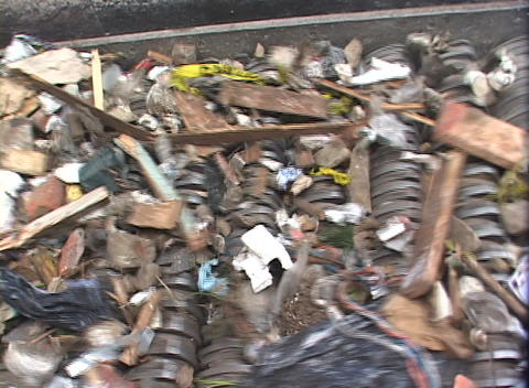 A conveyor belt separates garbage at a recycling center Footage